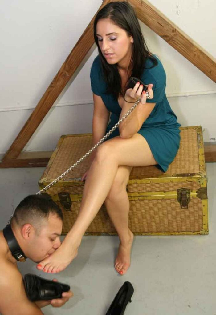 a mistress having her foot kissed
