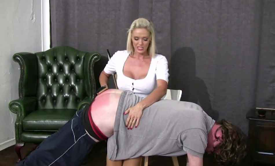 a mistress spanking a submissive over the knee