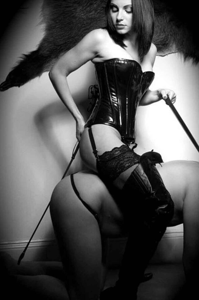 a mistress riding her submissive