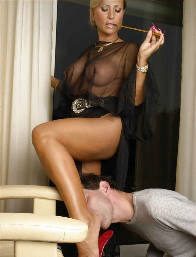 a blonde mistress getting her feet licked