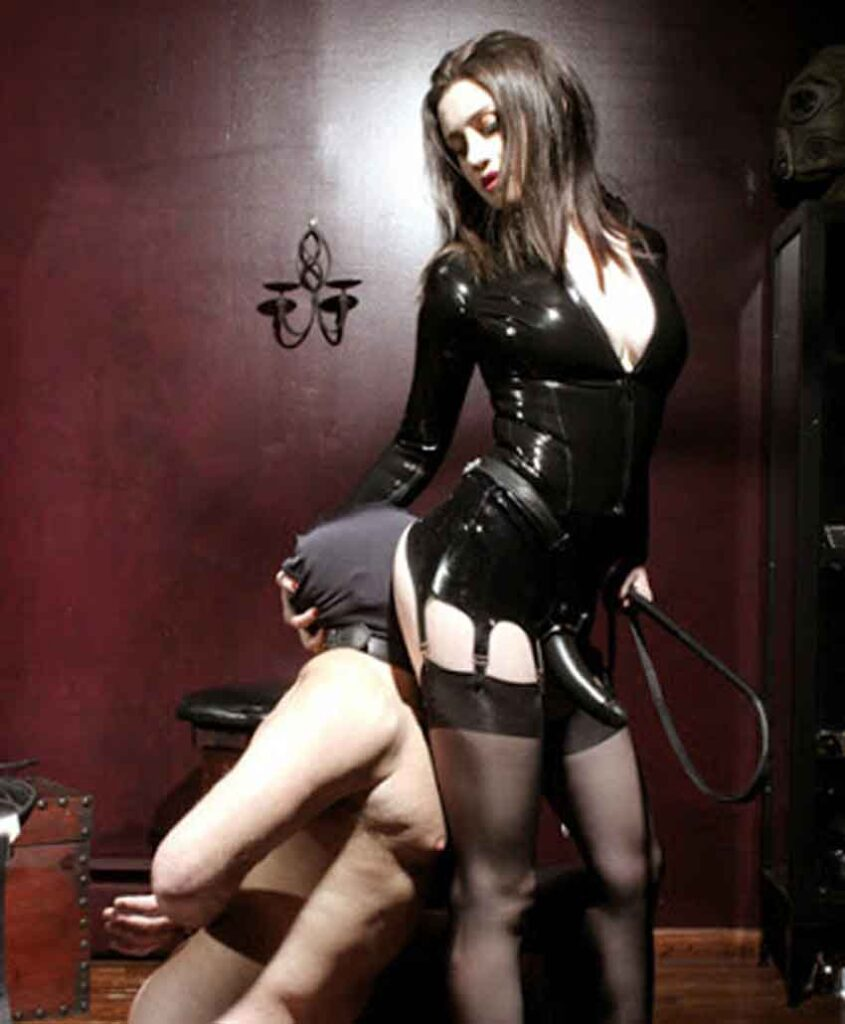 a mistress toying with her submissive
