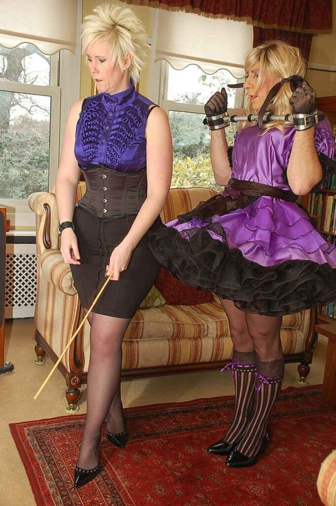 a mistress watches her sissy maid on a task